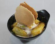 Kluay-Buat-Chi platano cocido en leche de coco